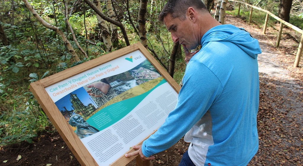 Iolo Williams reading one of the interpretation Panels